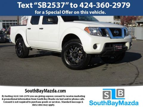 Pre-Owned 2015 Nissan Frontier 4WD Crew Cab SWB Auto SV